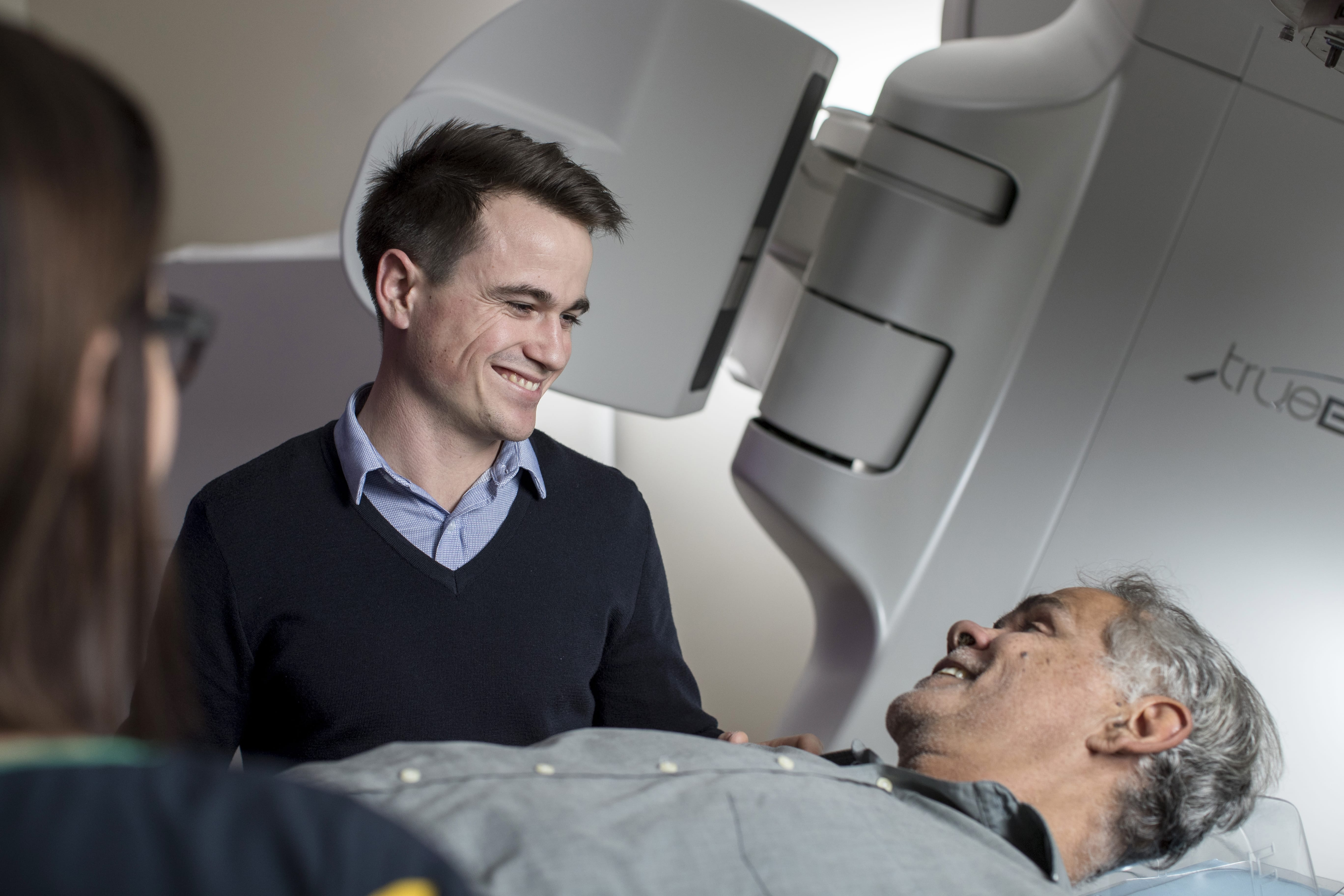 Doctor and patient experiiencing radiation therapy